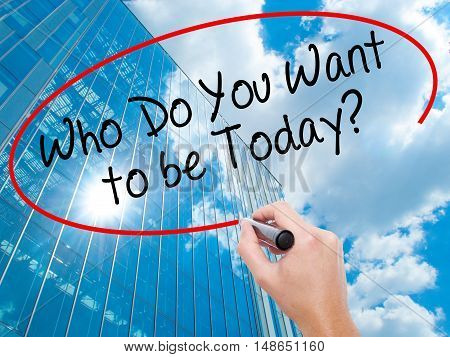 Man Hand Writing Who Do You Want To Be Today? With Black Marker On Visual Screen.