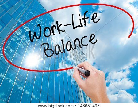 Man Hand Writing Work-life Balance With Black Marker On Visual Screen