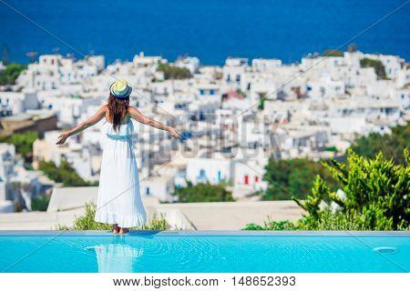 Beautiful woman enjoying summer vacation near pool