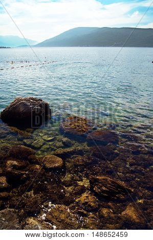 Morning landscape with a clean and clear sea water in Boka Bay (Montenegro)