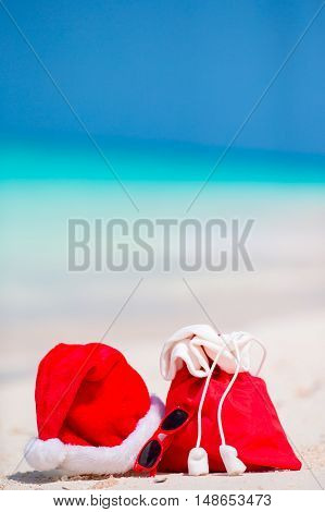 Closeup of bag and Santa Claus hat on beach