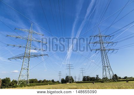 Electric Pylons Transporting Electricity Through High Tension Cables