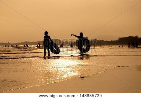 Silhouette of people standing on the beach