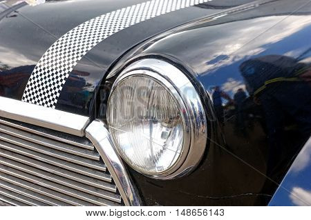 Kharkiv Ukraine - May 22 2016: Close up of retro car black Mini Cooper manufactured in 1966 is presented at the festival of vintage cars Kharkiv Retro Rally - 2016 in Kharkiv Ukraine on May 22 2016