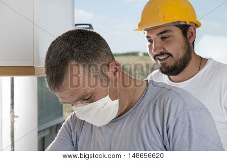 Head shot of manual workers at kitchen