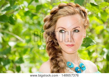 Portrait of the young beautiful smiling woman with long hair and outdoor