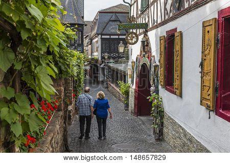 Rudesheim Germany - August 20 2016: Drosselgasse with tourists in Rudesheim near the river Rhine.