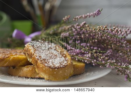 Yellow appetite toast with heather on background