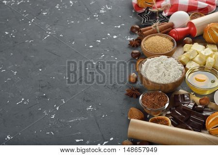 Raw ingredients for baking holiday cookies on a gray background