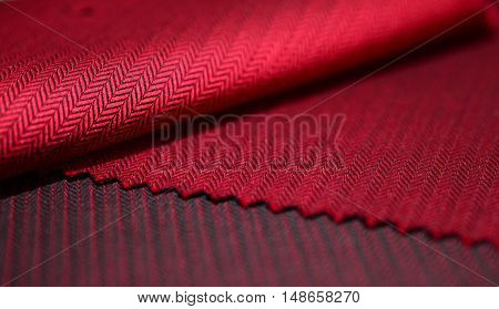 close up red fabric of shirt photo shoot by depth of field for object
