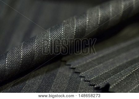 close up roll gray fabric of suit photoshoot by depth of field for object