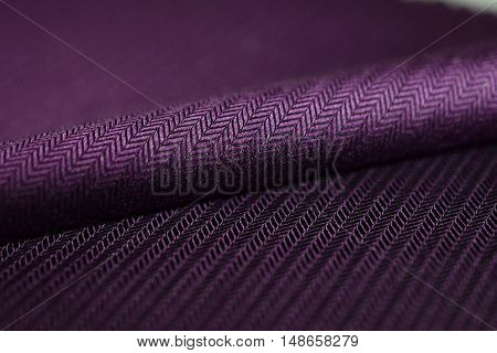 close up roll purple fabric of shirt photo shoot by depth of field for object
