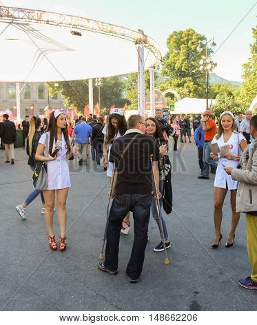 St. Petersburg, Russia - 12 August, Man on crutches and nurses,12 August, 2016. The annual International Festival of Motor Harley Davidson in St. Petersburg Ostrovsky Square.