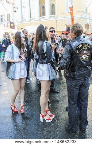 St. Petersburg, Russia - 12 August, Young girls in nurse clothes,12 August, 2016. The annual International Festival of Motor Harley Davidson in St. Petersburg Ostrovsky Square.