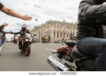 St. Petersburg, Russia - 13 August, Handshake on the move,13 August, 2016. The annual parade of Harley Davidson in the squares and streets of St. Petersburg.