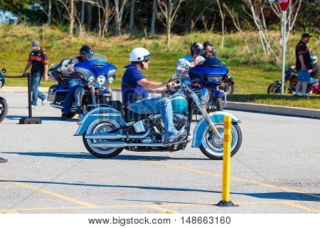 York PA - September 23 2016: Test Driving a new cycle at Harley-Davidson factory during the annual open house.