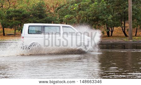 Driving Cars On A Flooded Road During Flooding Caused By Torrential Rains. Cars Float On Water Flood