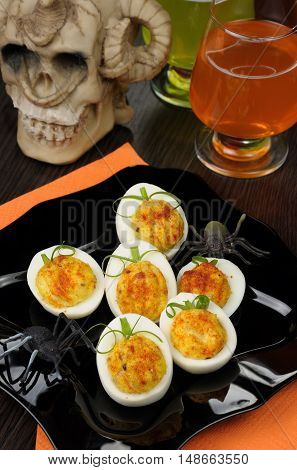 Stuffed eggs in the form of a pumpkin on the holiday table in honor of Halloween