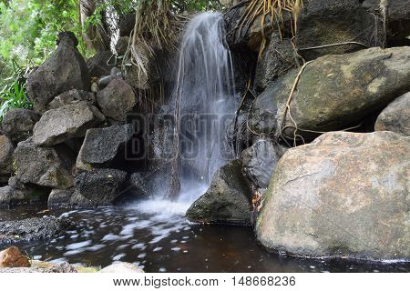 fountain stream landscaping and rock in garden