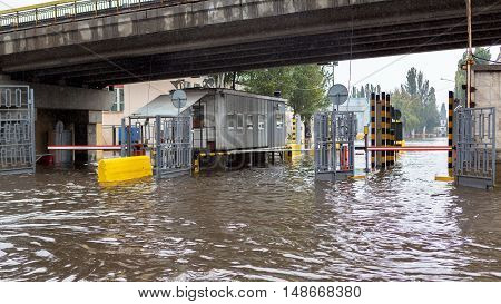 Driving cars on a flooded road during flooding caused by torrential rains. Cars float on water flooded streets. The disaster in Odessa
