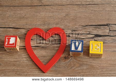 Valentine's Day. Love Spelled with colorful alphabet blocks and a red heart in the place of the o