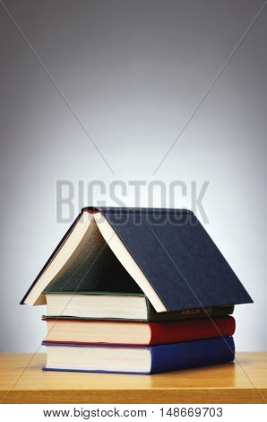 Books arranged in shape of house, studio shot