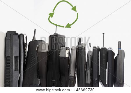 Pile of Old Phones with recycle symbol
