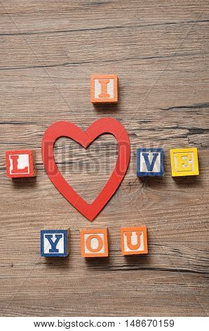 Valentine's Day.I Love you Spelled with colorful alphabet blocks and a red heart in the place of the o
