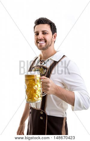 Young man in traditional bavarian costume on white background