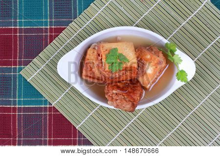 Gold bar soup as fried tofu wrap minced pork in soup and coriander