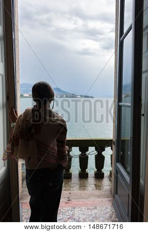 woman looking over Lake Maggiore and the Borromean Islands