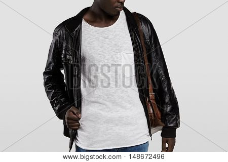 Indoor Portrait Of Attractive Young African Male Model Dressed Casually, Posing In Studio. Stylish D