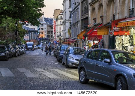 PARIS, FRANCE - MAY 12, 2015: It is one of the street in Montmartre in the evening at dusk.