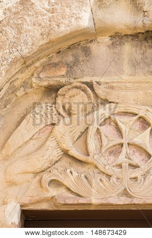 Mtskheta, Georgia. Close View Of Bas-Relief Glorification Of The Cross Crowning The Entrance To The Ancient Jvari Monastery, Georgian Orthodox Church Of Holy Cross, World Heritage By Unesco.