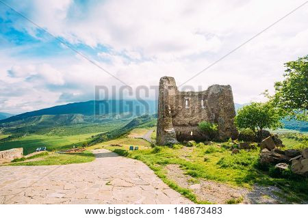 Mtskheta, Georgia. Ruined Wall Of Old Tower Near The Ancient Georgian Orthodox Church Of Holly Cross, Jvari Monastery With Remains Of Stone Wall, World Heritage. Scenic Blue Cloudy Sky Background.