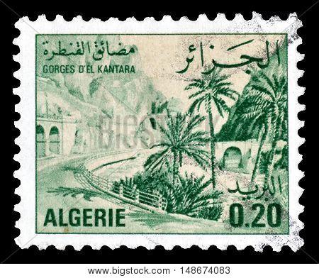 ALGERIA - CIRCA 1977 : Cancelled postage stamps printed by Algeria, that shows El Kantara Gorge.