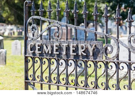 Black wrought iron cemetery gate.at old graveyard