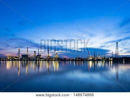 Oil refinery along Chao Phraya river at dusk Bangkok, Thailand