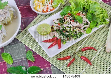 Spicy and sour mixed herb salad with pork and chicken  with side dish as mini vegetable salad and streamed gourd  wrap vermicelli and minced pork in bone soup on red green.