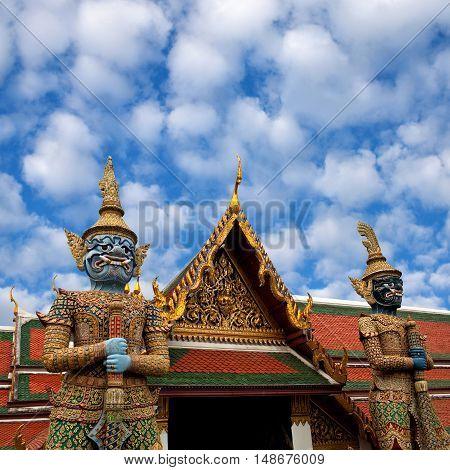 Thotsakhirithon, giant demon (Yaksha) guarding an exit to Grand Palace and Wat Phra Kaew temple in Bangkok, Thailand.