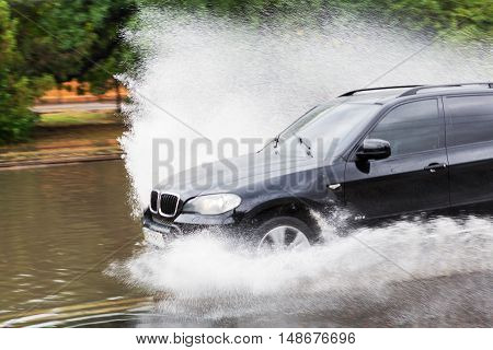 Odessa, Ukraine - September 20, 2016: Blur. Driving Cars On A Flooded Road During Flooding Caused By