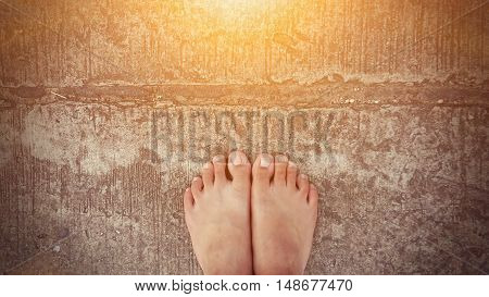 bare feet road background with sun ray effect