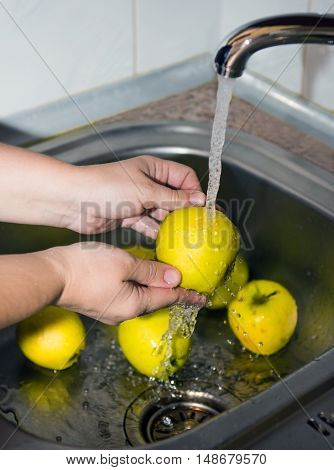 Wash fruits before eating. Protect health. Selective focus