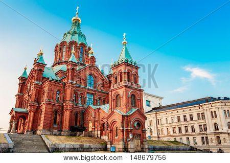 Helsinki, Finland. Uspenski Orthodox Cathedral Upon Hillside On The Katajanokka Peninsula Overlooking The City. Church Of Red Brick In Summer Sunny Day, The Popular Tourist Destination