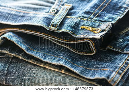Old cowboy jeans. Denim farric. Selective focus