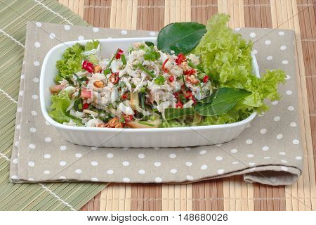 Spicy and sour mixed herb salad with crab