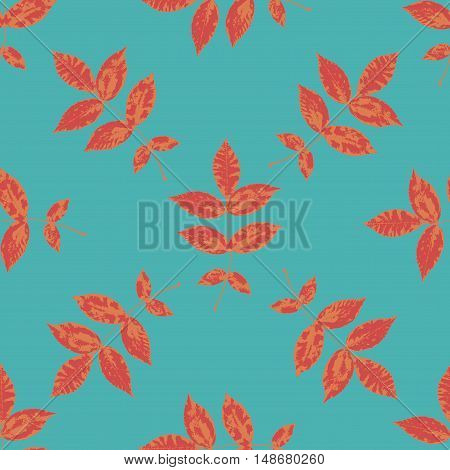 Floral seamless pattern with orange, red branches and leaves on blue. Autumn leaf background can be used for wallpaper, pattern fills, web page background,surface textures. Vector illustration.