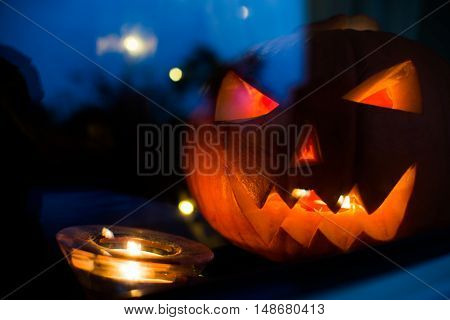 Halloween Pupkin Symbol Behind The Home Window With Light Reflectons At Night