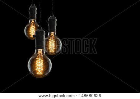 Idea Concept - Vintage Incandescent Bulbs On Black Background