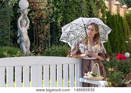 Girl With White Umbrella In The Summer Garden